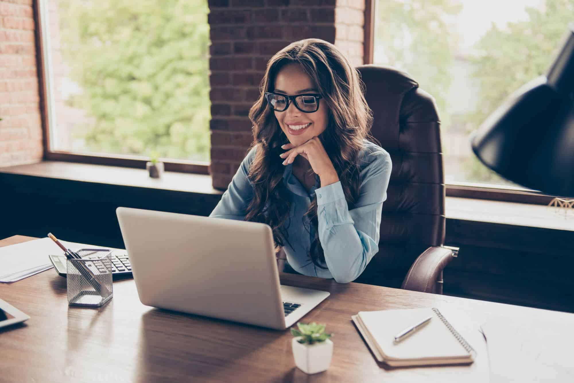 happy woman looking at her WordPress website